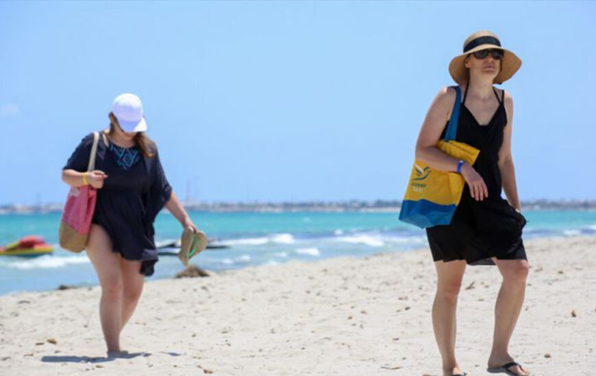 European tourists walk at the beach at a hotel on the Tunisian island of Djerba on July 18, 2020, a day after the arrival of the first charter flights to the country since the COVID-19 crisis erupted. AFP